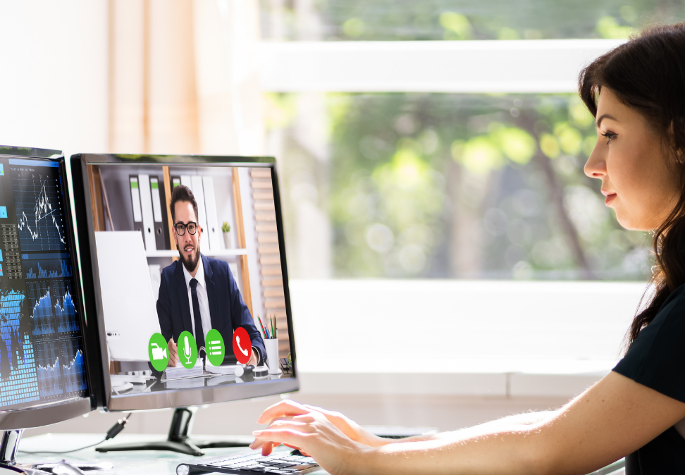 woman on computer has video conference with man about multifamily budgets