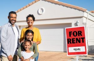 Shows family by a sign that say For Rent instead of For Sale